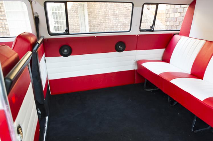 Red and White Interior of a Volkswagen bus